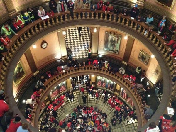Union supporters sitting on the first floor of the rotunda inside the Capitol in Lansing.