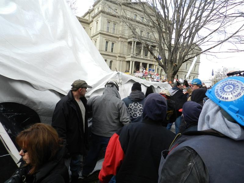 On Tuesday...union members tear down the tent set up by the pro Right to Work group, Americans for Prosperity
