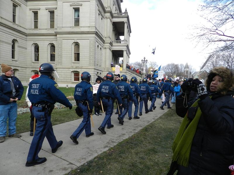 Michigan State Police around the Capitol in Lansing.