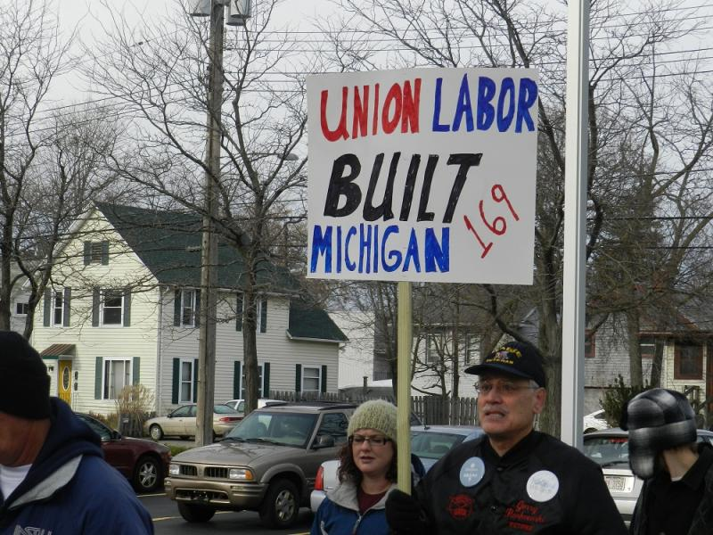Union workers picket outside the Michigan Chamber of Commerce