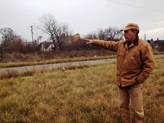 Mike Score explains plans to haul away trash and keep this area mowed.
