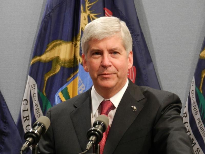 Michigan Gov. Snyder at a press conference on December 11, 2012 announcing he had signed 'right-to-work' into law.