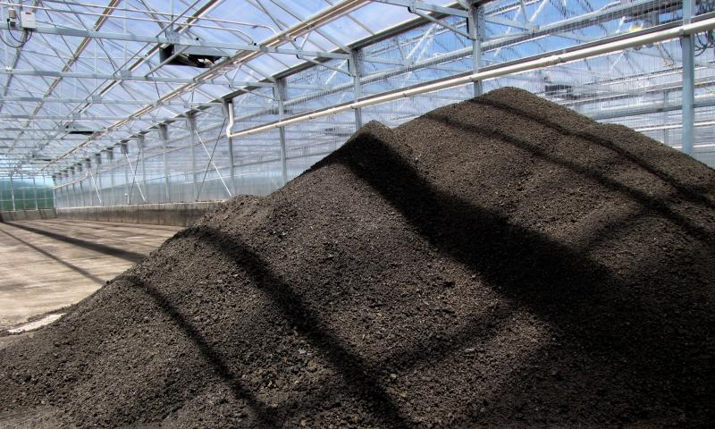 Biosolids drying in a greenhouse.