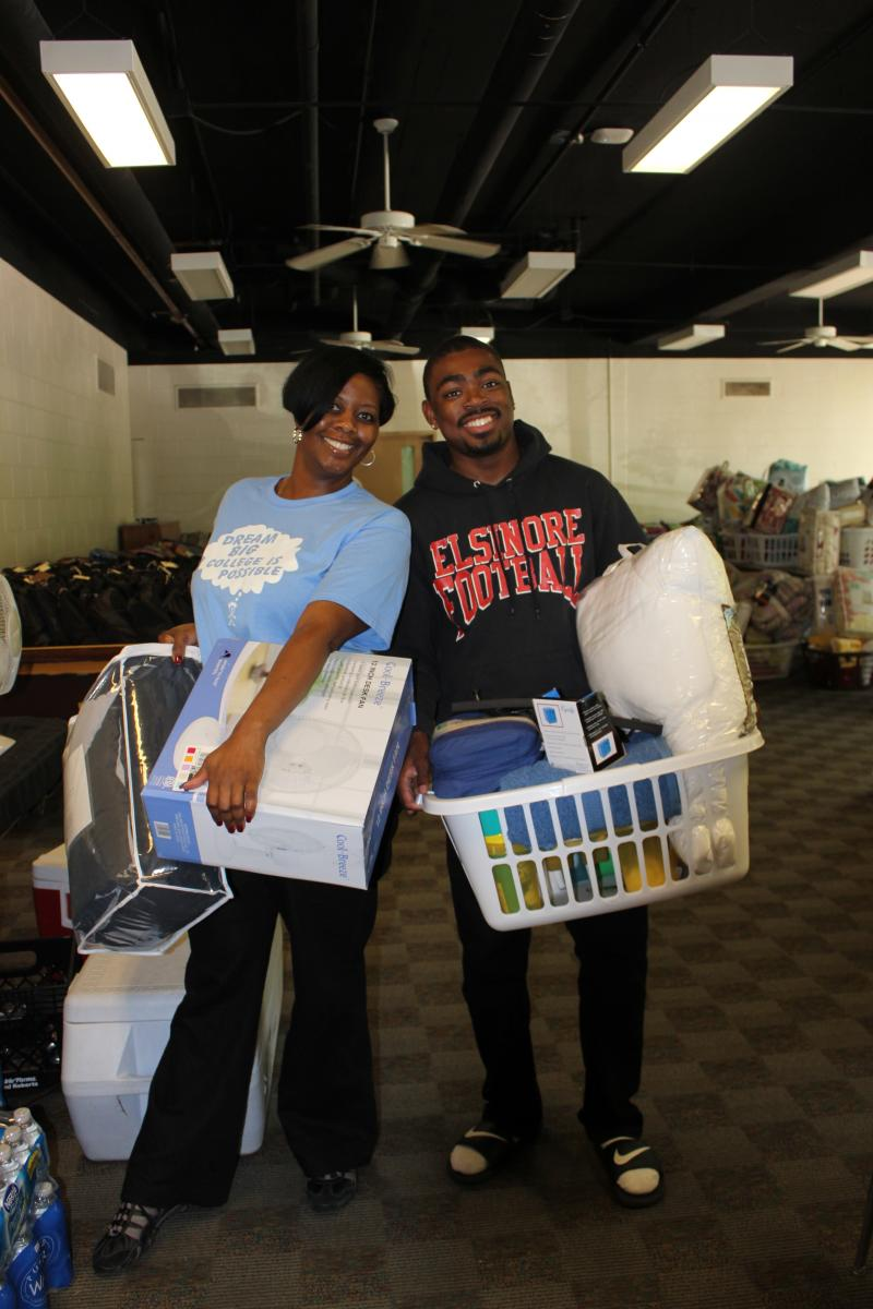 Ronicka Hamilton (Seita Scholars Campus Coach) helps Ricco Culberson with Welcome Pack supplies -- donated to help Freshman get settled in at WMU.