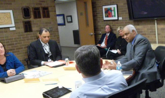 "Muskegon Heights schools emergency financial manager Don Weatherspoon (right) talks to Muskegon Area Intermediate School Board members. Without the MAISD's help, Weatherspoon said ""we would be probably still be fighting our way out of the mud."""