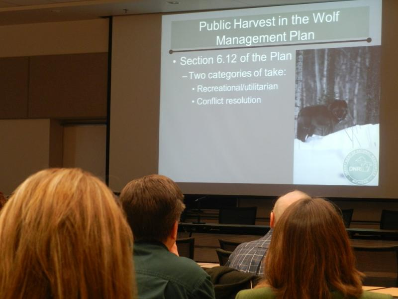 People listen to a presentation on a potential wolf hunt during today's meeting of the Michigan Natural Resources Commission
