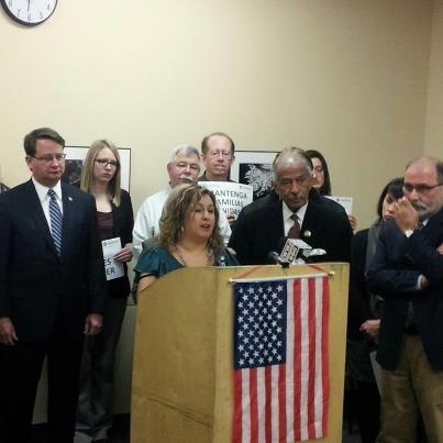 Cindy Garcia, center, flanked by Congressmen Gary Peters, John Conyers, and other supporters of immigration reform.