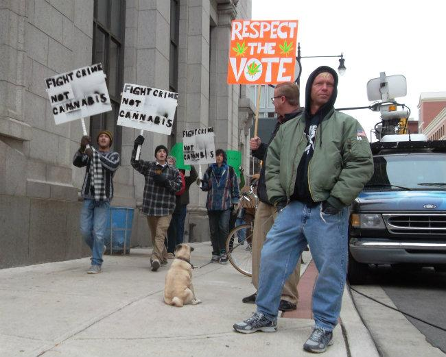 People protest in front of the Kent County Prosecutor's office in Grand Rapids in December 2012.