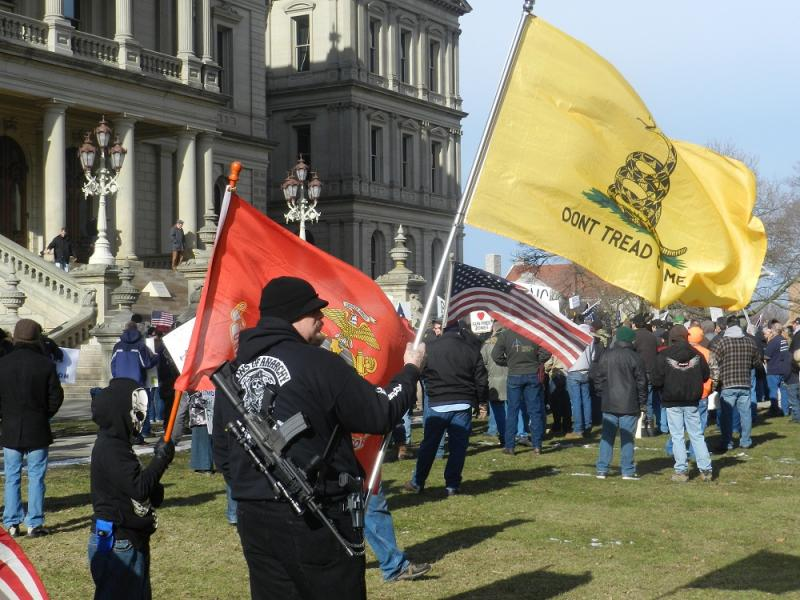 One of many gun rights supporters who showed up armed to the rally at the state capitol in Lansing