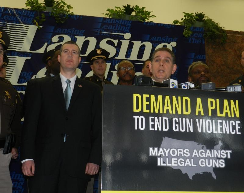Flint mayor Dayne Walling (left) listens as Lansing mayor Virg Bernero outlines changes being requested for the nation's gun laws