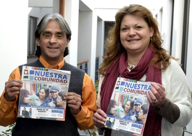 Joe Silva and Nicole Burns hold up the first edition of Nuestra Comunidad.