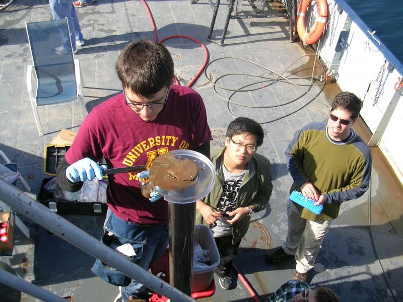 Dr. Arnold and his students take samples.