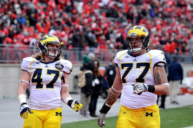 Taylor Lewan's (right) return to college football is one of the few positive stories to come from the new year.