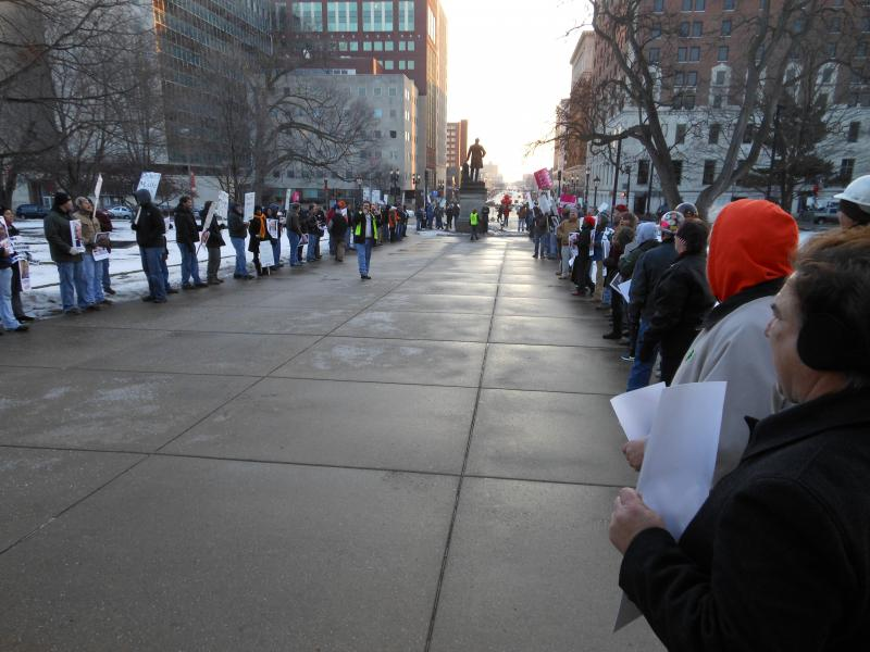 Union members demonstrate outside the state Capitol on the first day of the 2013-14 legislative session Wednesday.