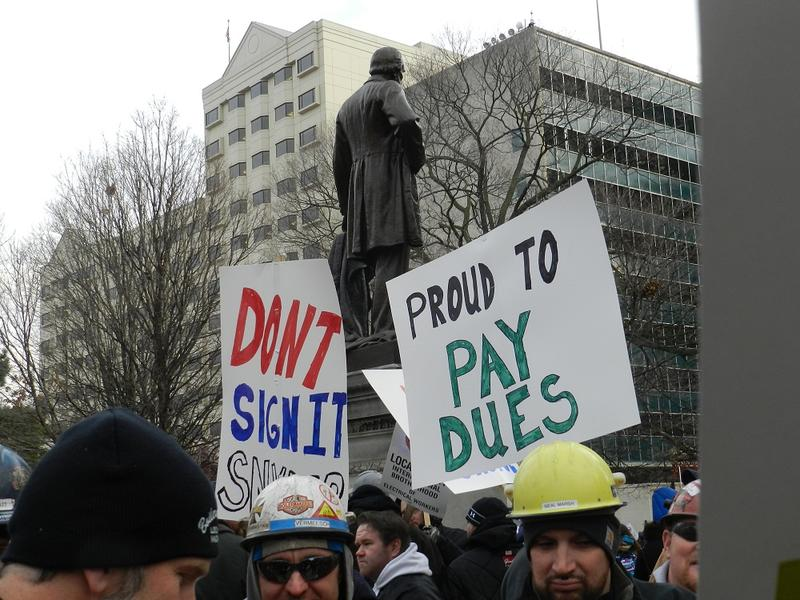 "Protestors gathered at the Capitol in December to oppose the passage of a ""right-to-work"" law"