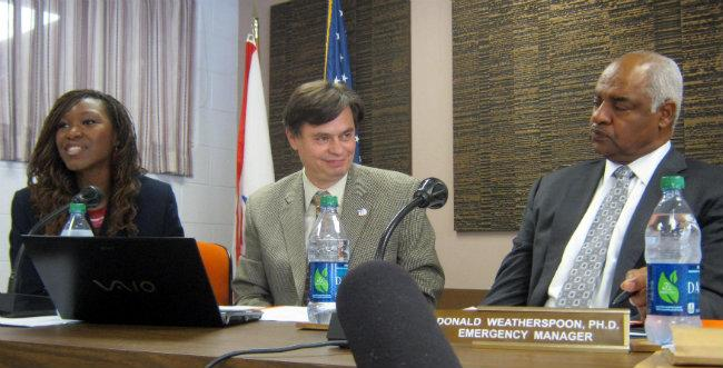 Mosaica Education's Alena Zachery-Ross and Gene Eidleman at a school board meeting in July, 2012. Emergency Manager Don Weatherspoon is on the right.