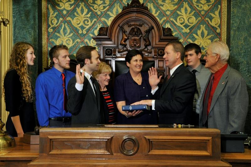 State Rep. Dan Lauwers, at right, taking the ceremonial oath of office as a state representative in the Michigan House.