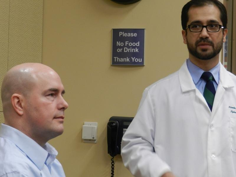 Dr. Syed Hussain (right), talks about Sparrow Hospital's cerifitication as a comprehensive stroke center.  42 year old James Cady (left) was treated for a stroke at Sparrow in 2011