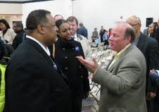 Detroit mayoral candidate Mike Duggan, right.