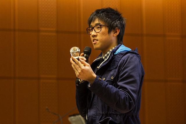 Wayne State University student Tom Kim makes a pitch for his LED lightbulb. It's made with vegetable glycerin.