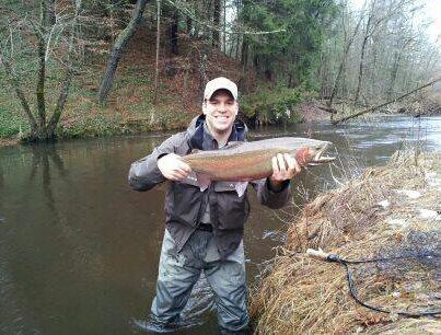 Patrick Streit with a 10 pound male steelhead on the Pere Marquette River.
