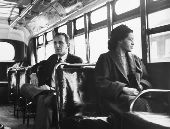 Parks on a Montgomery bus on December 21, 1956, the day Montgomery's public transportation system was legally integrated.