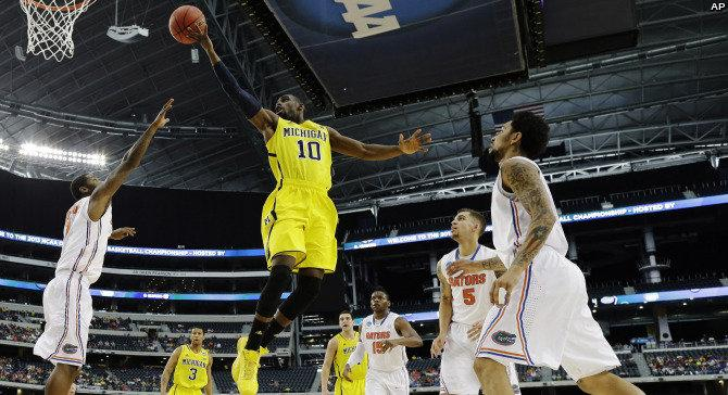 Wolverine Tim Hardaway Jr sails to the basket in Sunday's Elite Eight win over the Florida Gators