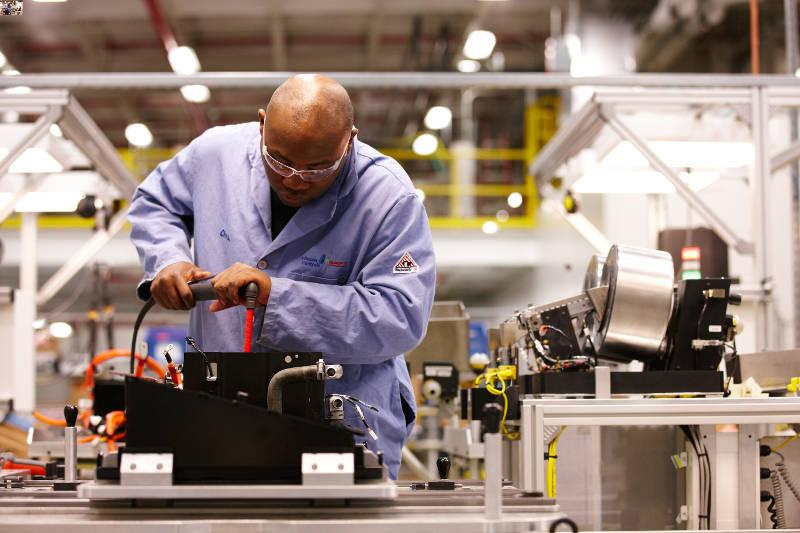 Workers at Johnson Controls' Meadowbrook plant assemble lithium ion battery packs.