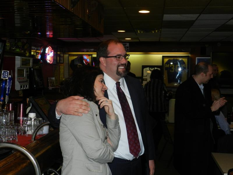 Candidate Jim Ananich hugs his wife Andrea after winning Tuesday's Democratic primary.  He'll face Robert Daunt in the May general election to serve out the unexpired term in the 27th state senate district seat.