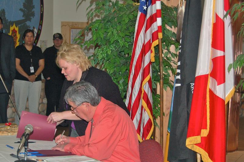 Little Traverse Bay Band of Odawa Indians Tribal Chairman Dexter McNamara signs the same sex marriage statue into law