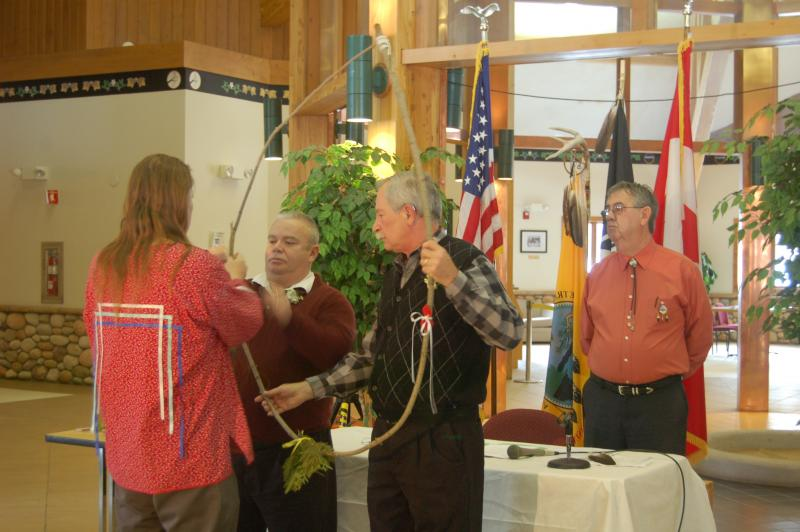 Fred Harrington (left) leads a traditional Odawa wedding ceremony for Tim LaCroix (center left) and Gene Barfield (center right)