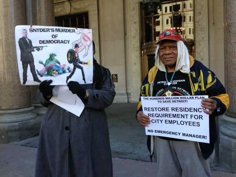 Issiac Blue, AKA Big Blue, right, opposes an emergency manager for Detroit