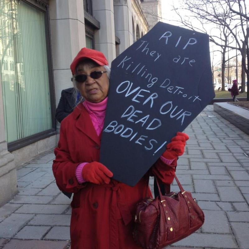 Emergency manager protestor outside Cadillac Place in Detroit.