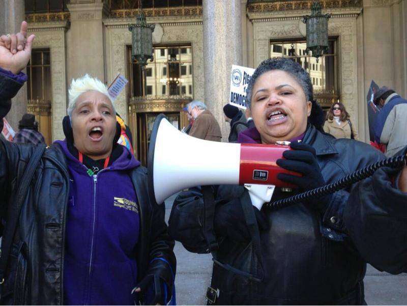"""""""Whose city? Our city! Whose money? Our money!"""" Protestors outside the Detroit emergency manager press conference - Cadillac Place, Detroit."""