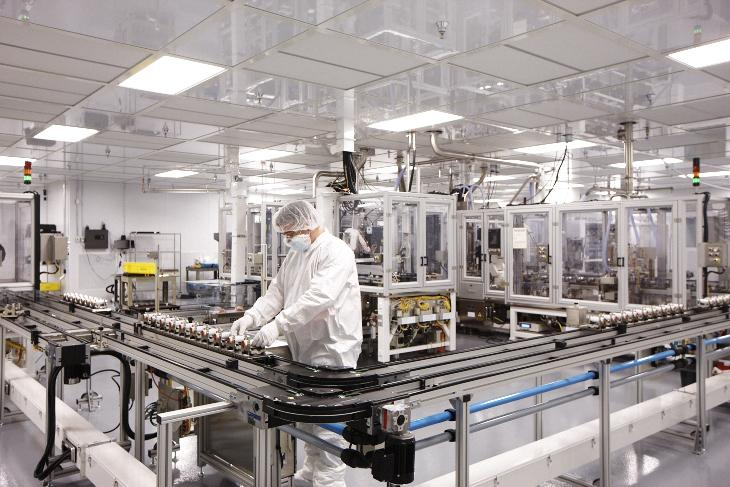 "The beginning of lithium ion batteries in the form of ""jelly rolls"" come down the assembly line at Johnson Controls' plant in Holland."