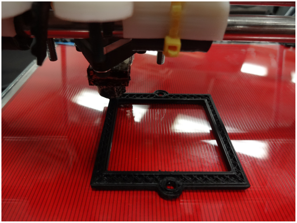 A 3-D printer making an optical component