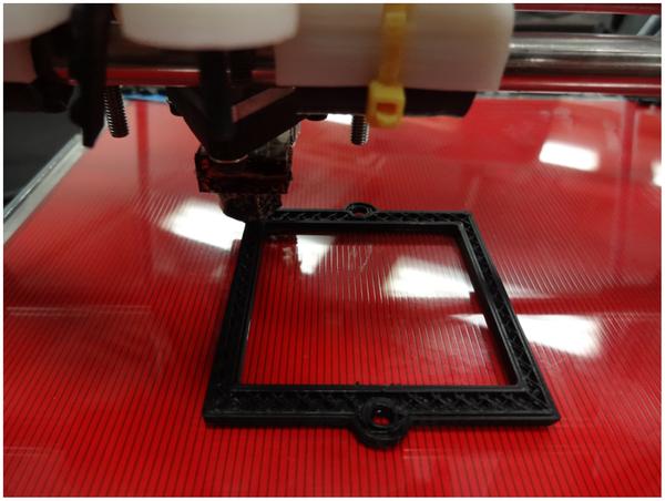 A 3-D printer making an optical component