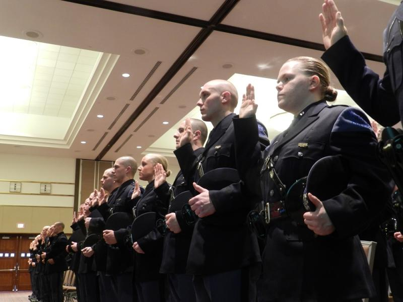 New Michigan State Police troopers are sworn in during ceremonnies in Lansing