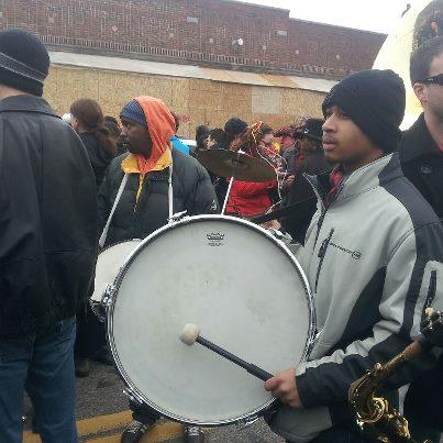 Drumming at the Marche du Nain Rouge.