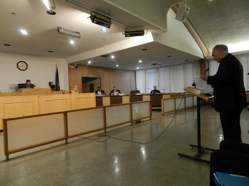 Genesee County Drain Commissioner Jeff Wright (right) addresses last night's Flint city council meeting