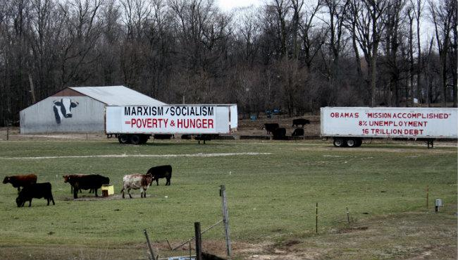 The signs are attatched to Verduin's trailers used on the cattle farm.
