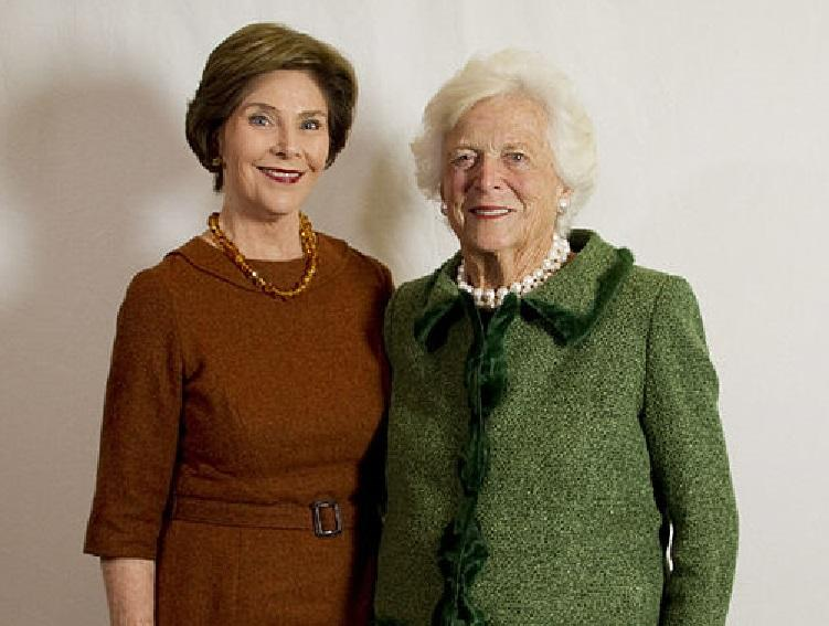 Former First Ladies Barbara Bush (right) and Laura Bush at the LBJ Presidential Library in 2012.