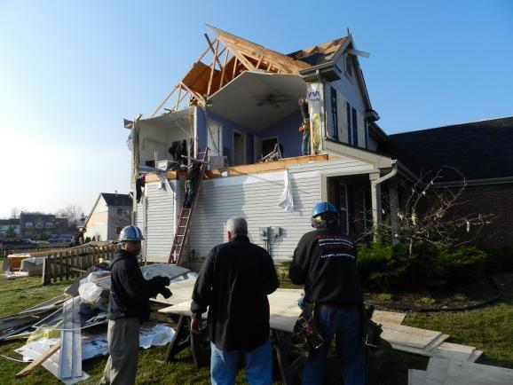 Cleaning up after the Dexter tornado in March of 2012.