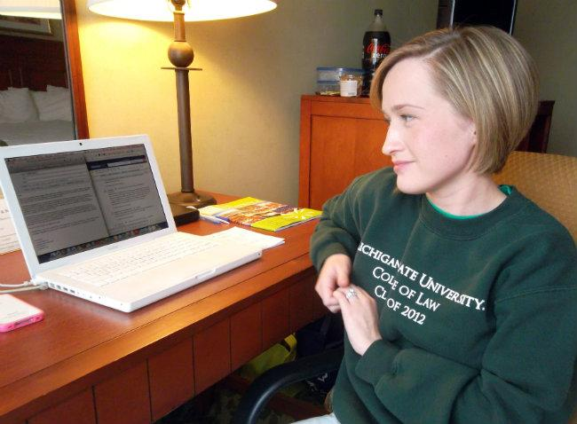 Sheila Eddy's home office has been relocated to her hotel room after flooding issues closed Plaza Towers.