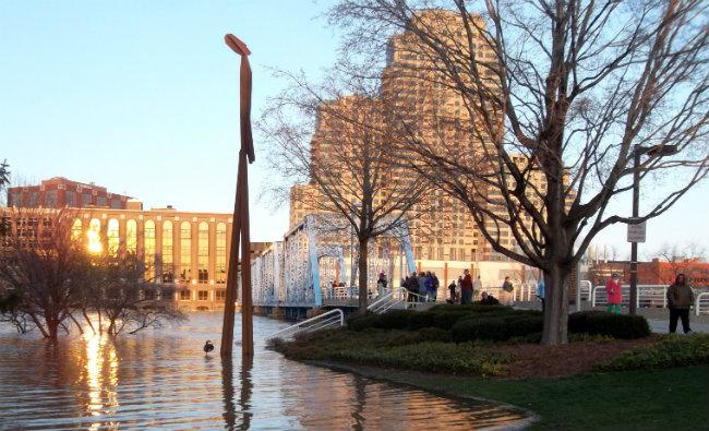 Hundreds, if not thousands of people came downtown to check out the flooded Grand River in Grand Rapids on Sunday.
