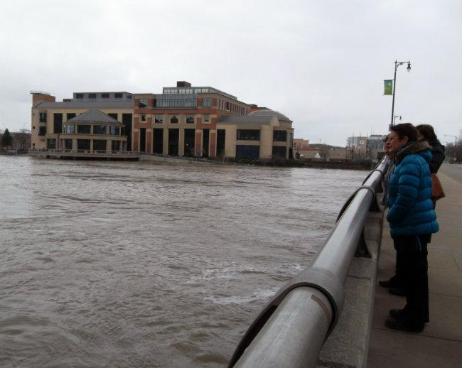 Lots of people came downtown on Saturday to check out the flooded Grand River. The Grand Rapids Public Museum is in the background.