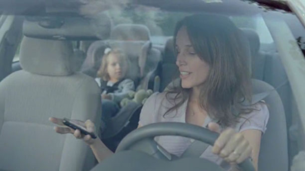 Keep your eyes on the road and both hands on the wheel, Mom.