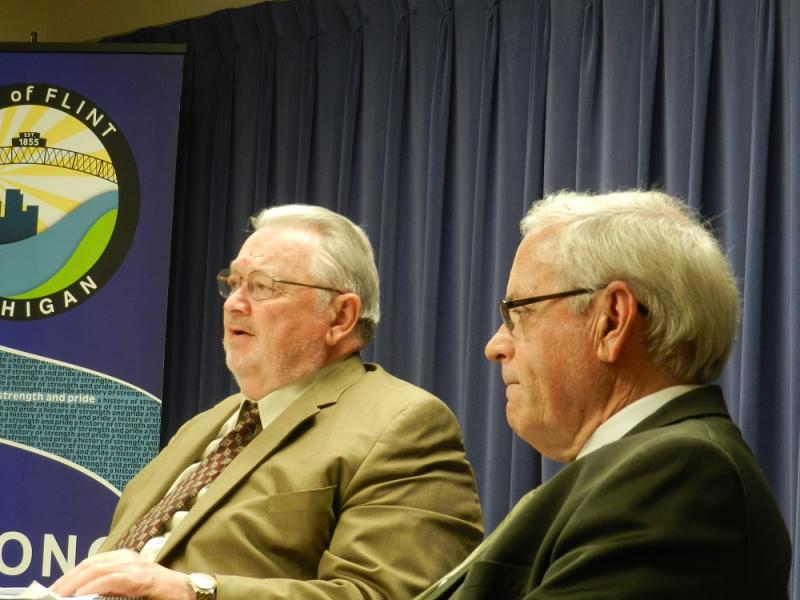 Flint Emergency Manager Ed Kurtz (left) answers questions about the FY2014 budget, while Jerry Ambrose, Financial Advisor to Emergency Manager, listens