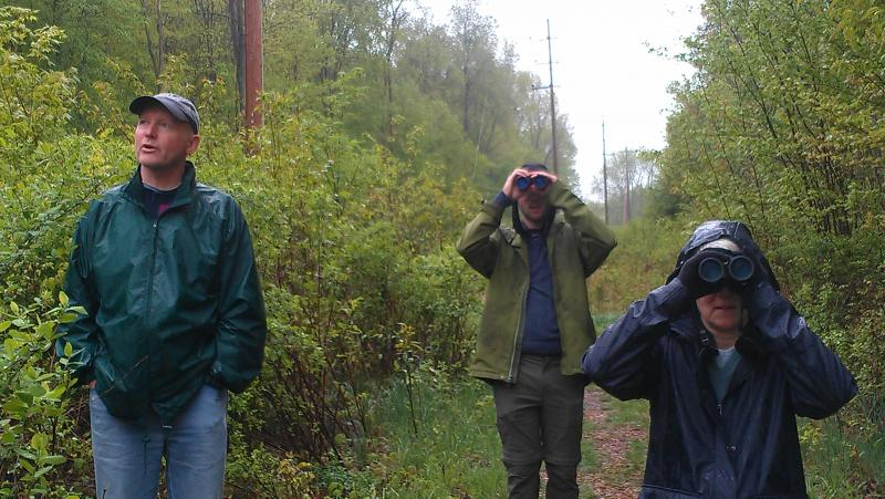 Jeff McKelvey, Evan Kowalski and Jill Goodell look for birds in the Blandford Nature Center.