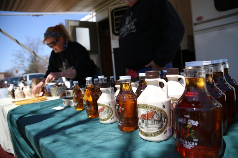 Stephanie Thorne from Trail's End Maple Syrup in Vermontville, Mich., shows off her syrup products at the Vermontville Maple Syrup Festival.